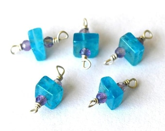 Gorgeous 1 consists of a 2 small amethyst and neon Apatite rondelle connector bead