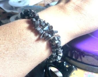 Braided bracelet with hematite chips