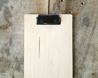 Simple wood clipboard, natural maple with black clip. Clipboards for check presenters and menu holders, retail signs and more.