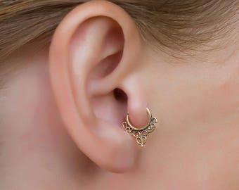Gold ear tragus. tragus earring. tiny hoop earrings. daith piercing. helix earring.