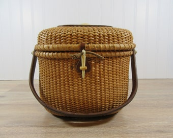 REDUCED.....Nantucket lightship basket purse with swing wood handle, clasp, hinged lid , wood base, shell top design- nice condition