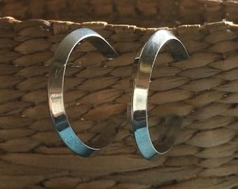Sterling hoop earrings. Triangular tube shape, Well made everyday elegance.