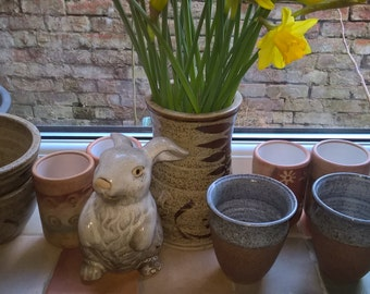 Pair of Northumbrian Pottery hand thrown stoneware beakers, wine cups or vases Terracotta with a speckled grey glaze at the rim and inside .