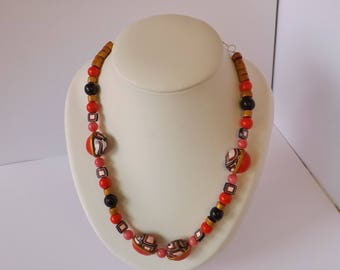 ethnic black, gold, red, pink necklace, polymer clay