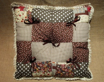 Brown square patchwork cushion