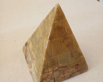The original pyramids are not but a 7.5 cm high soapstone pyramid from Peru