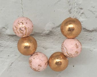 Rose Gold  and Pink beaded necklace with Silver Plated Chain and Toggle.
