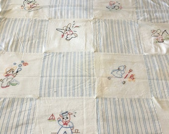 1950's Vintage baby quilt / handstitched embroidered blocks / blue white pinstripes /embroidered animals kids tufting /43 x 35 /baby gift
