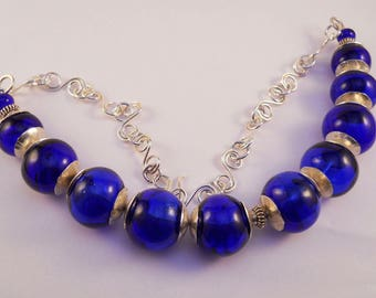 Cobalt recycled hollow blown bead necklace with Sterling silver end caps, spacers and handmade chain