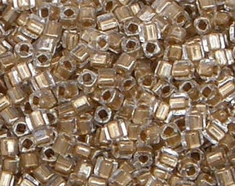 Toho 3mm Cube, Gold Lined Crystal (989), 10 grams