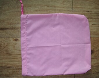 Drawstring tote bag for shopping cart covers.