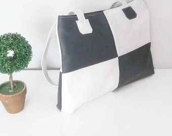 Grey charcoal and white Orion bag