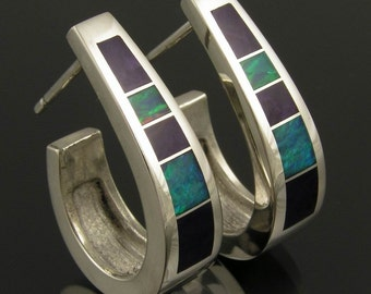Sterling silver earrings inlaid with sugilite and Australian opal by Mark Hileman.