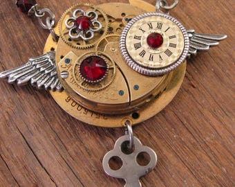 Steampunk Jewelry - Watch Movement & Watch Parts Mixed Metal, Ruby Crystal Winged Industrial or Steampunk Necklace with Skeleton Key Charm