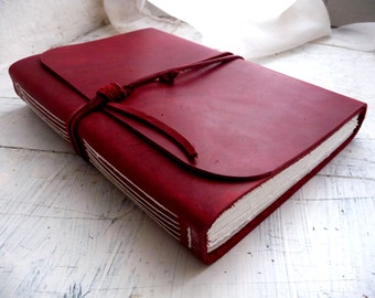 Large Red Leather journal measures 16cm by 21.5cm