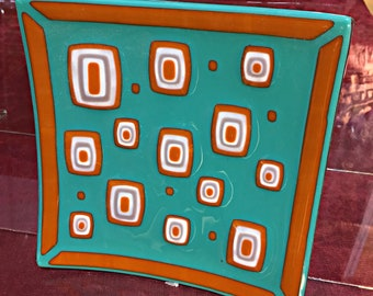 """Square fused glass plate. """"Mid-Century"""" Teal/burnt-orange/french-vanilla fused glass. 9 3/16"""" square. (368)"""