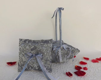 Silver wedding ring pillow and Flower girl basket decorated with embroidered lace.