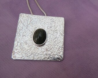 Sterling Silver Pendant.  (16)