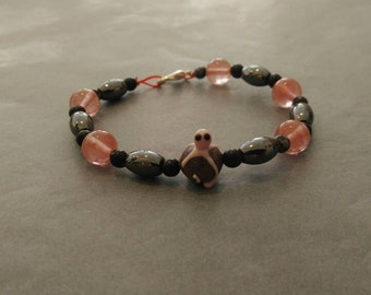 Pink bracelet with glass Octopus