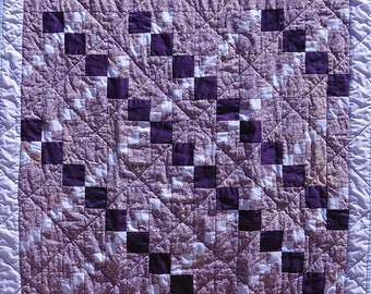 Purple to lavender diamond pattern quilt measuring 41 inches by 32 inches
