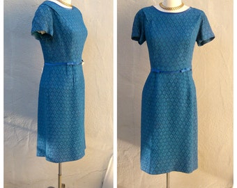 "60s cocktail dress / belted Mad Men dress / teal cloque matelasse fabric / 60s blue dress / satin trim bows / medium large 39"" bust, MINT"
