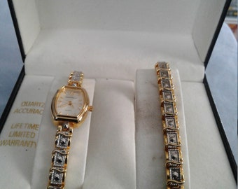 Jaclyn Smith watch and bracelet set.