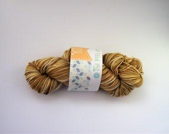 """Merino Superwash/Silk hand dyed yarn. """"Golden Boy"""""""