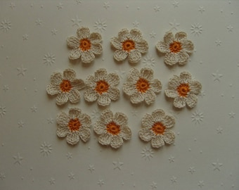 Crocheted appliques, set of 10, off-white and orange flowers