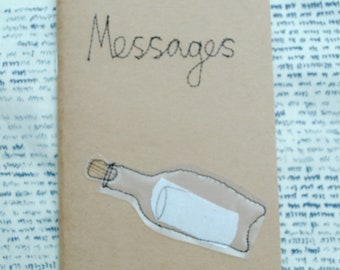 A6 notebook/sketchbook with homemade machine embroidery textile design felt Message in a bottle perfect for reminders on the go