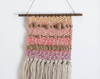 Natural and ombré woven wall hanging
