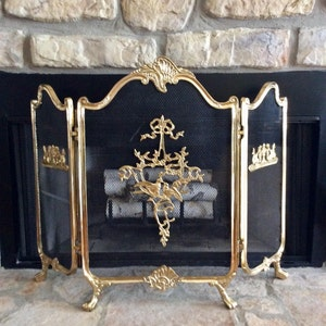 antique fireplace screen. vintage ornate brass fireplace screen, footed, french rococo style, tri fold, embellished antique screen