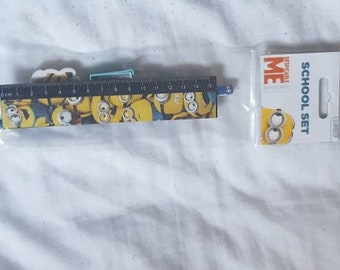 Dispicable Me kids stationary set including Dispicable Me pencil, sharpener and rubber.