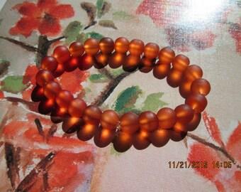 136  frosted round tangerine glass beaded handmade bracelet