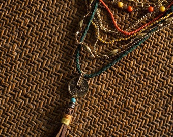 Ethnic, Multi Strand Leather Coin Necklace with Green, Coral and Yellow Beads and leather Tassle