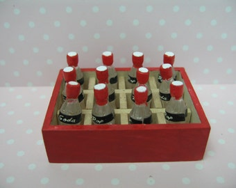 Miniature dolls house 12 soda bottle in a container