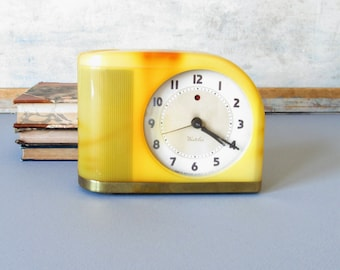 Vintage Westclox alarm clock, art deco clock, yellow Bakelite alarm clock display, art deco decor.