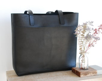Black Leather tote bag with large outside pocket. Cap Sa Sal Bag. Handmade.