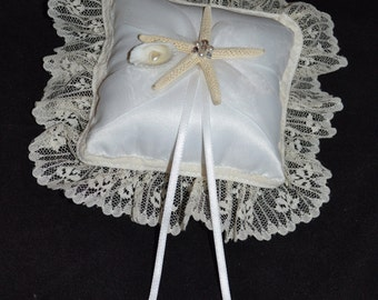 Elegant and luxurious ivory ring bearer pillow with lace, sea shells, rhinestones and pearls. Wedding pillow
