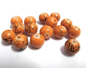 10 orange beads, black round painted glass 8mm