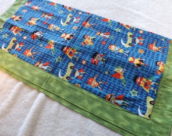 newborn, baby, lap, receiving, or dog blanket made from Superhero kids flannel with green backing