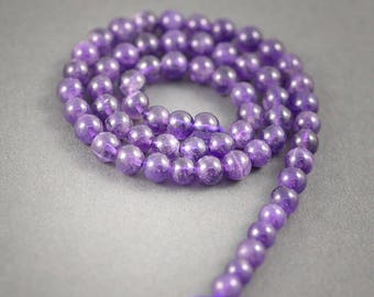 Amethyst wire 38cms, 65 beads 6mm approx • • Amethyst veins and inclusions, natural colors