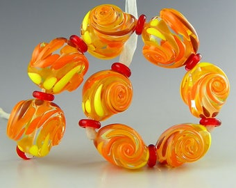handmade lampwork glass bead set of 8 bright twisted nuggets orange yellow red on clear glass - Tropical Breeze
