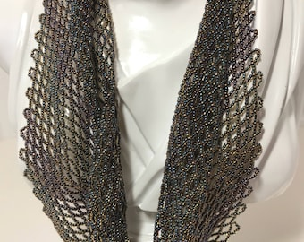 Handwoven beaded scarf inshades of amber and purple