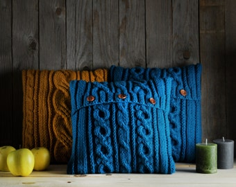 Sea green cable knit pillow cover with 3 wooden buttons.