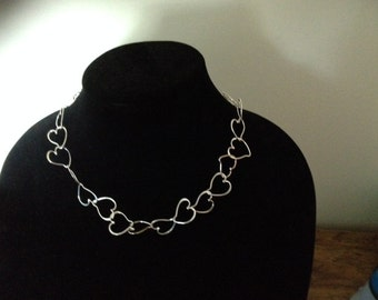 Sterling silver  chain of hearts.