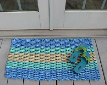 blue aqua and tan handwoven doormat from lobster trap rope.