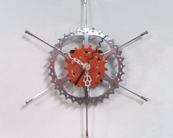 Two Sprocket Star Clock in Silver and Orange