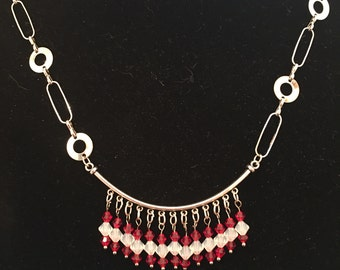 24 inch necklace in silver with red and white Swarovski crystals .