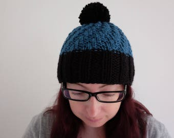 Knitted teal/black winter woolly hat with bobble/pom pom