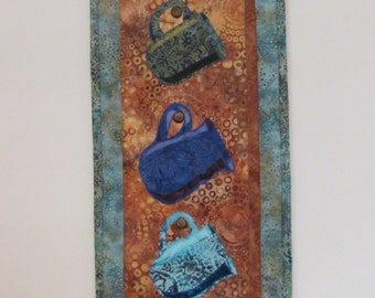 """Mug Mix Up – Quilted Wall Hanging in blues – 29"""" x 10"""""""